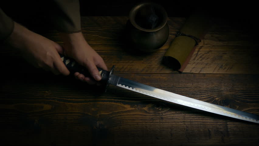Samurai Sword Is Picked Up Off Table | Shutterstock HD Video #1024101986