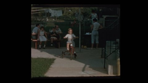 Baltimore, Maryland, USA- 1956: Cute little boy on antique tricycle