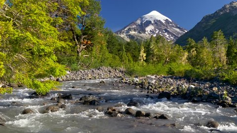 Lanin volcano in Lanin national park. Landscape with volcano, mountain river and green trees. Argentina, Patagonia, Lake district
