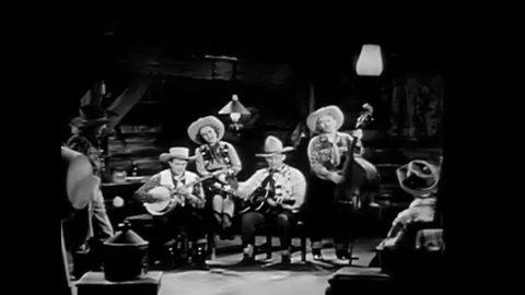 CIRCA 1940s - Lonesome cowboy Carson Robison sings a Western ballad in the 1940s.