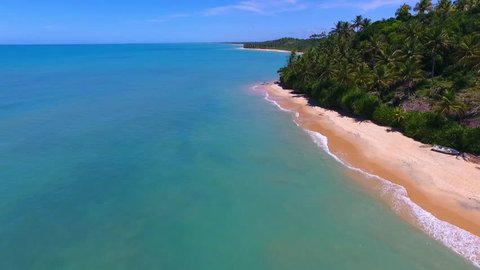 Aerial view of a blue sea and clear weather. Fantastic landscape. Great beach view. Caraiva, Bahia, Brazil. Vacation on deserted beaches. Travel destination. Tropical travel.