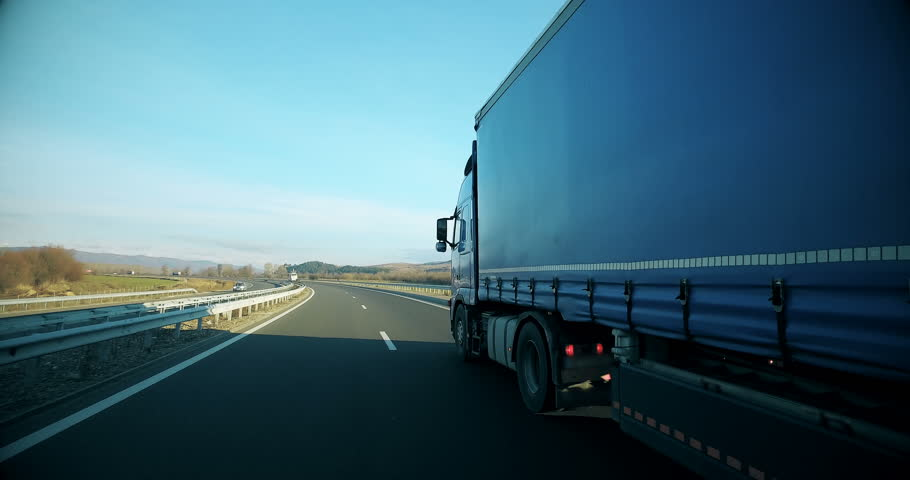 Delivery traffic, semi trailer delivery lorry truck with cargo trailer drive fast on highway | Shutterstock HD Video #1024305116