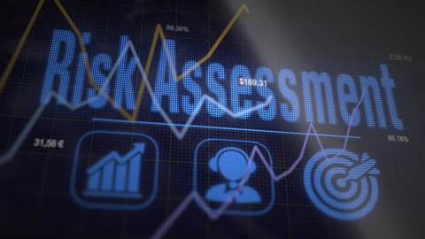 Risk Assessment business concept on a flashing computer monitor with moving graphs and data.