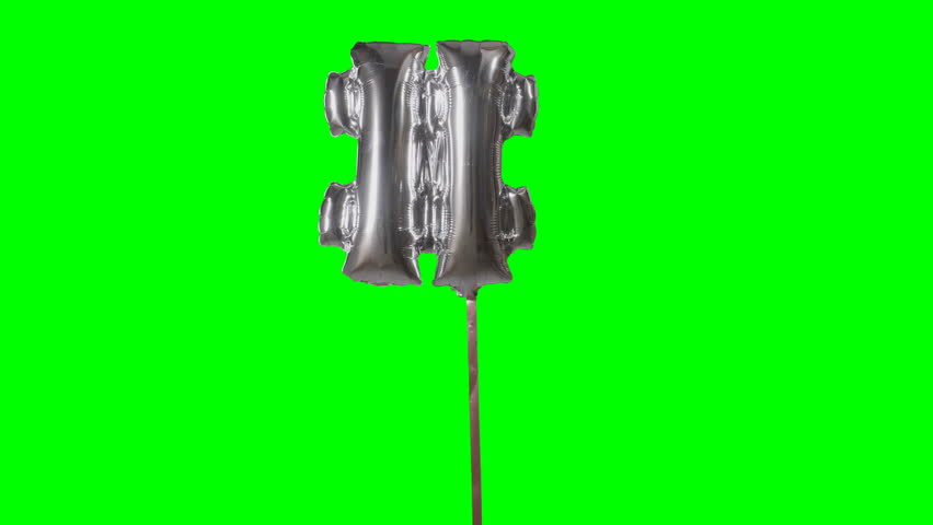 Sign symbol number hash pound and from alphabet helium silver balloon floating on green screen