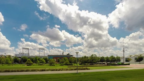 Summer Clouds roll in panning time-lapse over Birmingham, Alabama's Railroad Park overlooking the baseball stadium