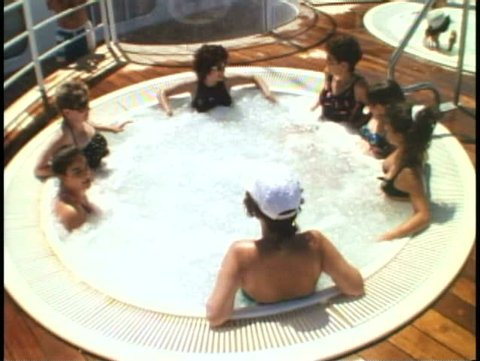 AT SEA, ATLANTIC OCEAN, 1994, People in Jacuzzi on a cruise ship