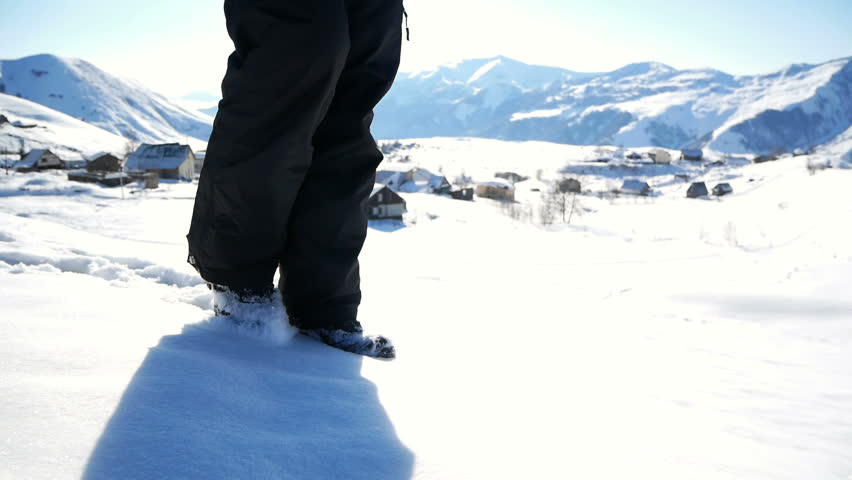 Close up of man feet walking on the mountains in the snow | Shutterstock HD Video #1024478786