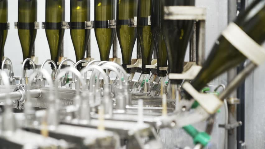Slow-motion, glass bottles on the automatic conveyor line at the champagne or wine factory. Plant for bottling alcoholic beverages   Shutterstock HD Video #1024484876