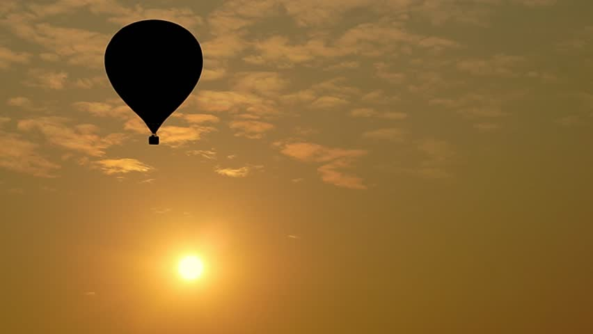 Silhouette Colorful hot air balloons floating in orange sky in Chiang Rai, Thailand #1024525316