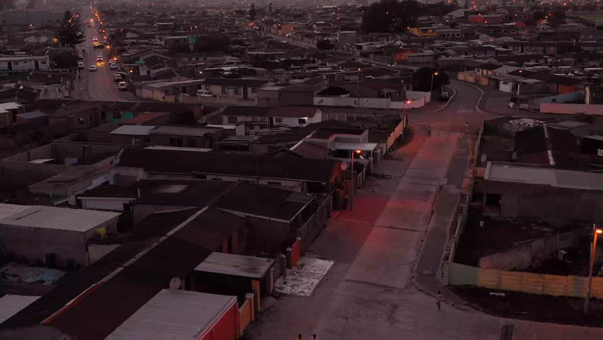 GUGULETHU, SOUTH AFRICA - CIRCA 2018 - Spectacular aerial over township in South Africa, vast poverty and ramshackle huts, at night or dusk. | Shutterstock HD Video #1024542386
