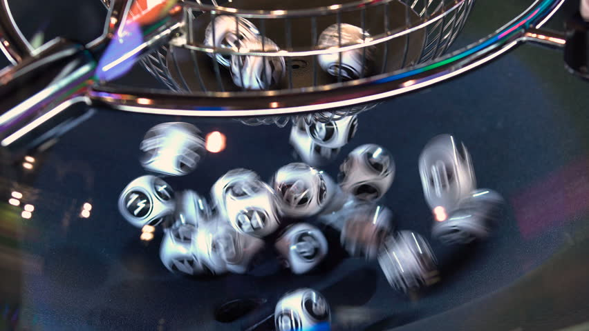 Black and white lottery balls in a rotating bingo machine. Lottery balls in a sphere in motion. Gambling machine and euqipment. Blurred lottery balls in a lotto machine. 4k | Shutterstock HD Video #1024550246