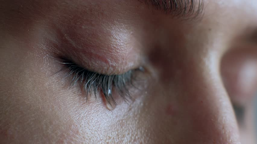 The female eye cries and tears are flowing macro video. Close-up woman eye cries and tears flow. 4k. Macro shoot. | Shutterstock HD Video #1024586726