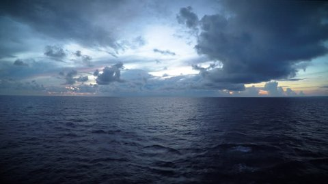 A dark, moody sky over the open sea.