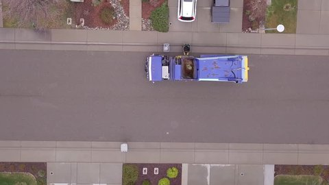 Aerial top down view of garbage truck or dustbin lorry collecting trash.