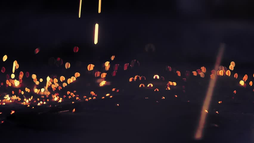 Beautiful sparks, fireworks, round bokeh, welding, sparklers, on a dark von | Shutterstock HD Video #1024637816
