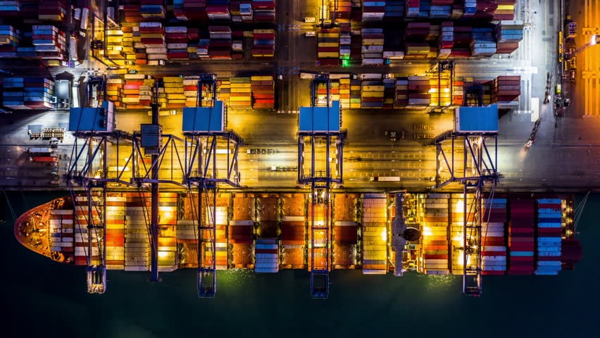 Container cargo freight ship with working crane bridge discharge at container terminal, Aerial top view container ship at deep sea port at night, Singapore. | Shutterstock HD Video #1024664966