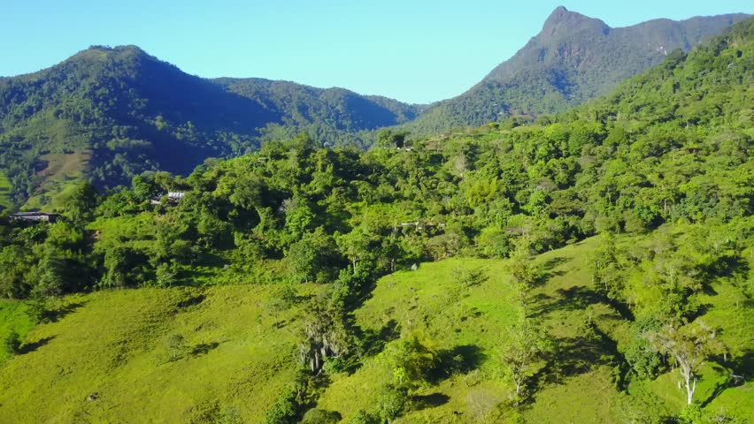 AERIAL: Flying over a hill with the mountains in the background near Cali, Colombia.