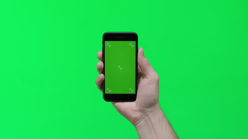 Male hand holding smart device on green screen chroma background making gestures, zoom in, pinch, swipe, scroll | Shutterstock HD Video #1024737656