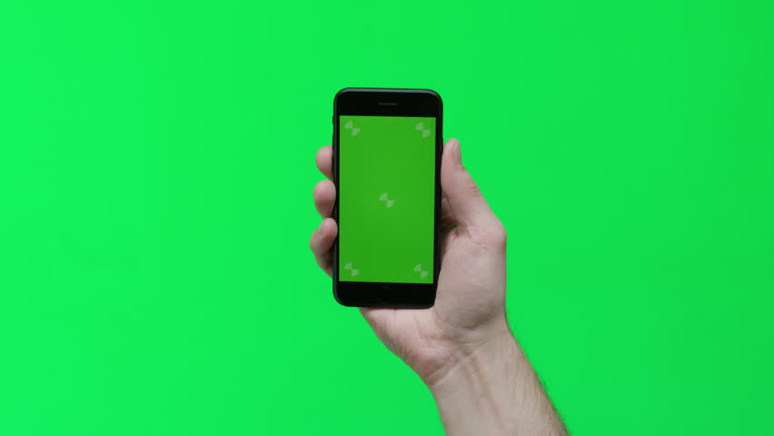 Male hand holding smart device on green screen chroma background making gestures, zoom in, pinch, swipe, scroll | Shutterstock HD Video #1024737686