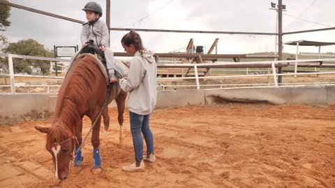 Horse riding therapeutic session shot