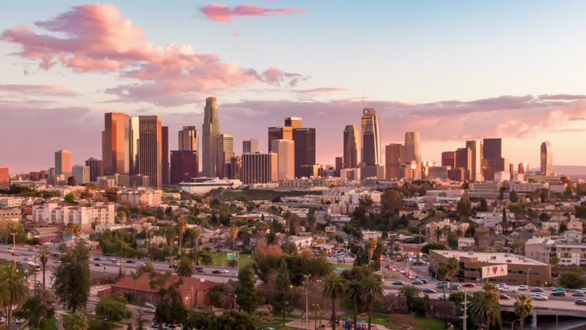 Aerial time lapse in motion or hyperlapse over Echo Park of downtown Los Angeles, California skyline and skyscrapers from above on a sunny day during golden hour before sunset.