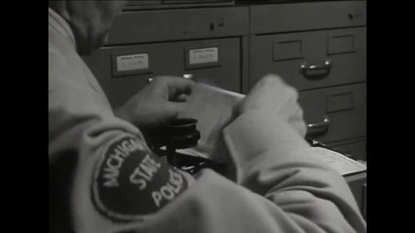 CIRCA 1930s - State police track down criminals in 1939 using fingerprints.