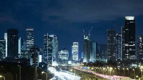 Tel Aviv Skyline and Ayalon Freeway Time lapse At Night Time - Tilt Down, Toned In Blue Color, Israel