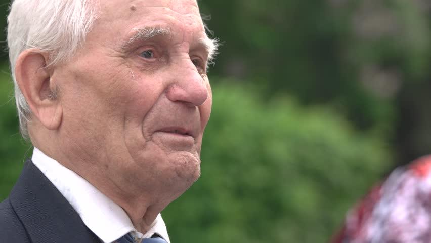 09.05.2018, Ukraine, Kiev. Old senior talking man. Happy smiling veteran. Close up face. | Shutterstock HD Video #1024992176