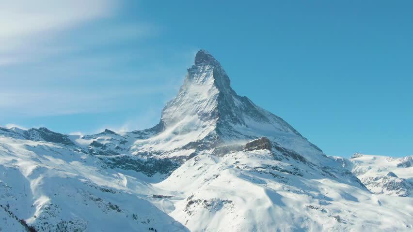 Matterhorn Mountain in Winter Sunny Day. Switzerland. Aerial View. Medium Shot. Drone Flies Sideways | Shutterstock HD Video #1025234456