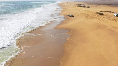 NAMIBIA, AFRICA - CIRCA 2018 - Incredible aerial shot of a humpback dead whale lying on an abandoned beach along the Skeleton Coast of Namibia.
