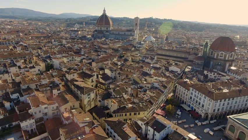 Drone flying over Florence in golden hour Brunelleschi's Dome, Medici Kapelle, Piazza della Repubblica | Shutterstock HD Video #1025331446