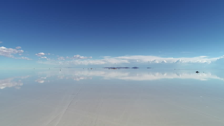 Aerial view of world's largest salt flat Salar de Uyuni, sky reflection on water surface - landscape panorama of Bolivia from above, South America | Shutterstock HD Video #1025367146