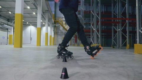 professional rollerskater doing slalom in the logistics center slowmotion