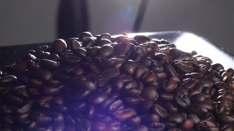 Brown roasted coffee beans grains gyrating