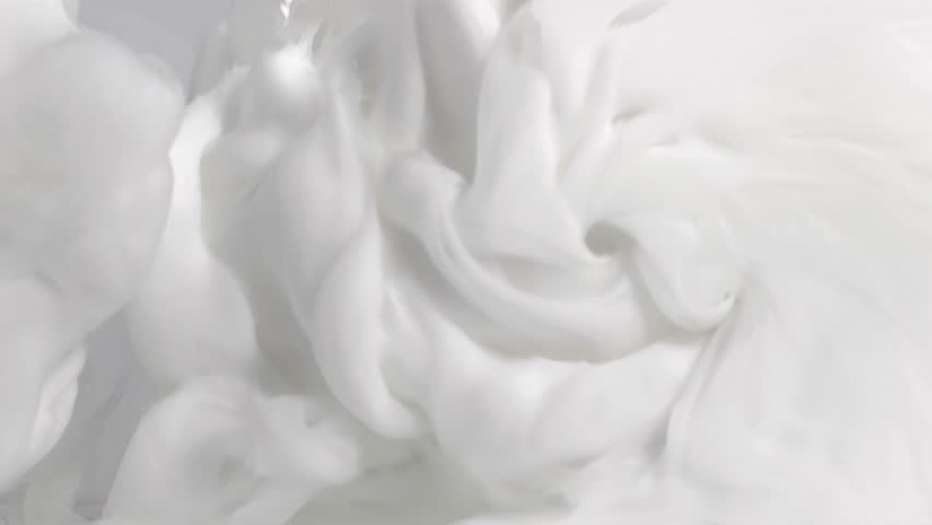 Macro 4k slow motion of milk cream waves and drops splash mixing with each other in water. | Shutterstock HD Video #1025645246