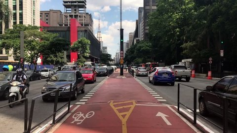 Sao Paulo, Brazil - March 5, 2019: Car traffic at rush hour on Paulista Avenue near MASP and Trianon Park, Sao Paulo city.
