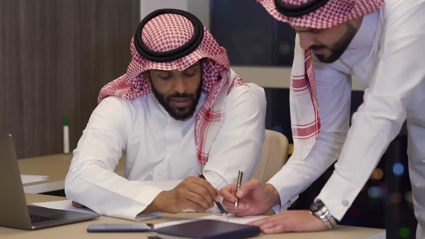 Desk job, Saudi business meeting, writng on paper Saudi Arabia Company | Shutterstock HD Video #1025673566
