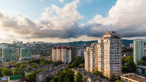 Time-lapse video of day to night transition. Aerial view of the apartment district of the city of Sochi, Russia