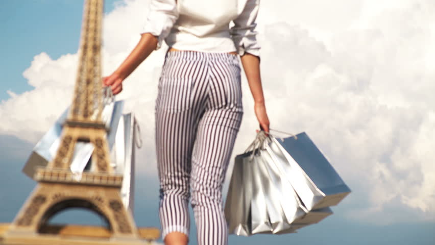 Shopping in Paris, fashion woman near Eiffel Tower in France. Young woman doing shopping in Paris. Shopping time concept. Beautiful woman holding many shopping bags with Eiffel Tower on background   Shutterstock HD Video #1025752106