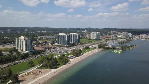 Flying with drone above downtown of Barrie and Lake Simcoe 4k