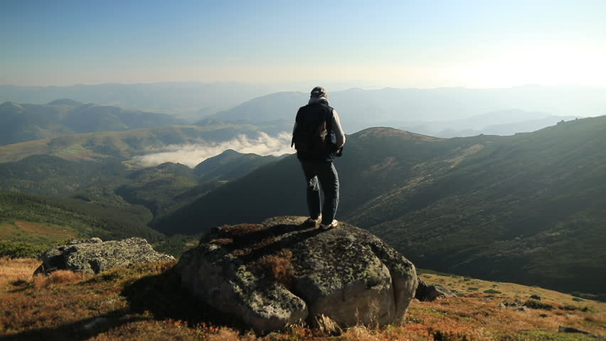 Young man on top of a mountain. Beautiful sunrise landscape. #1025796926