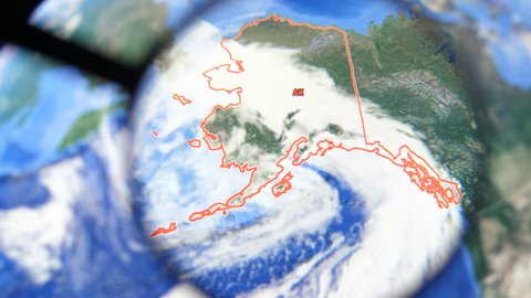 MIAMI BEACH. FLORIDA. USA - MARCH 2019: USA, Alaska on the political map. The borders of Alaska. Alaska State under a magnifying glass. Geography of Alaska in the USA