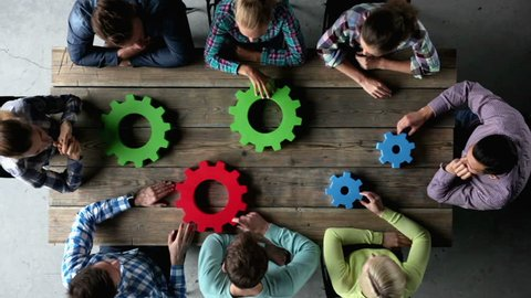 Business people with colorful cogs of business, problem sloution concept