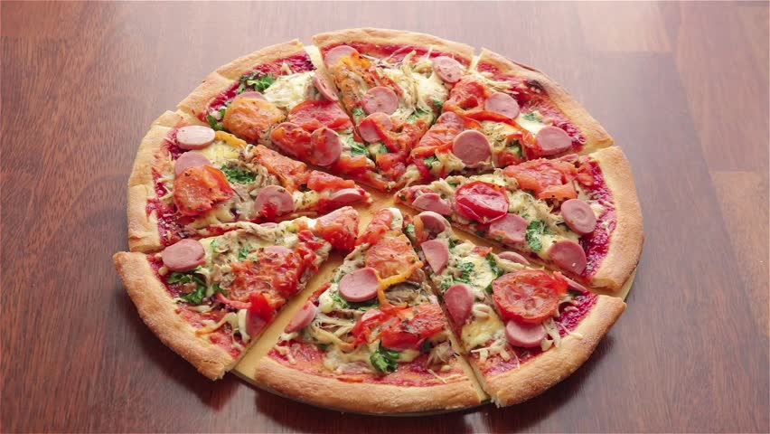 Man and woman take pizza slices with sausage tomatoes cheese   Shutterstock HD Video #1025813486