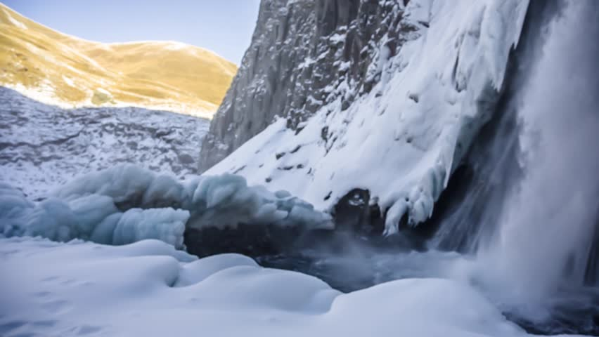 Winter falls in mountain rocks, the wild nature of the North Caucasus | Shutterstock HD Video #1025826146