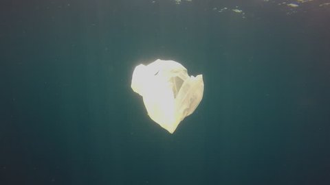 Plastic pollution in ocean. Plastic bags pollute the sea