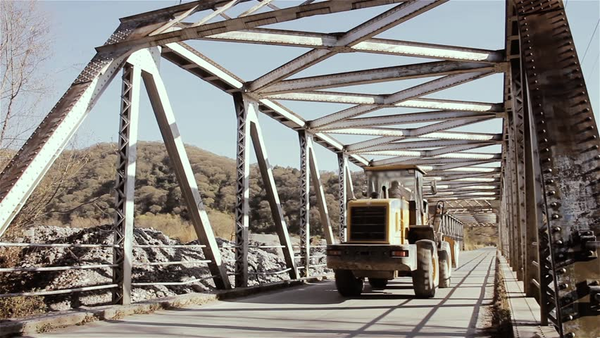 Tractor Over an Old Steel Bridge in the Quebrada de Humahuaca, Jujuy Province, Argentina.    Shutterstock HD Video #1025865206