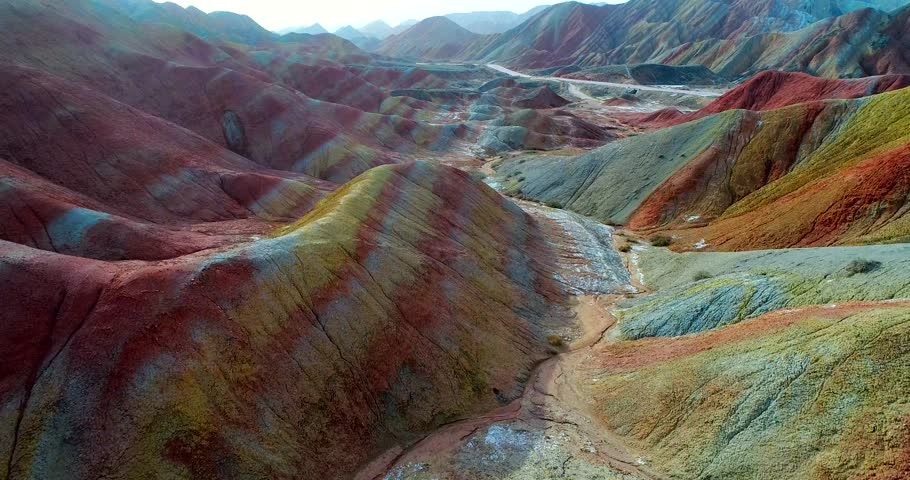 Aerial rainbow mountain landscape in 4k. Drone footage showing the most beautiful valley in Zhangye National Geopark, with sandstone hills covered by colorful pattern. Zhangye Danxia, Gansu, China.