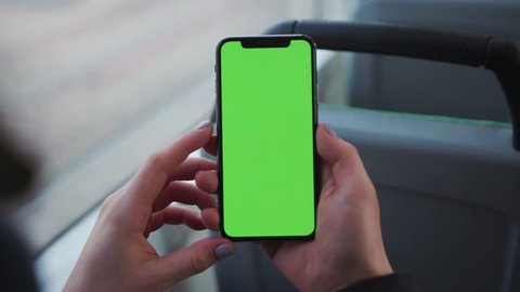 Lviv Ukraine May 19 2018 Close Up Of A Woman S Hand Holding A Mobile Telephone With A Vertical Green Screen In Tram Chroma Key Smartphone Technology Cell Phone Street Touch Message Display Hand
