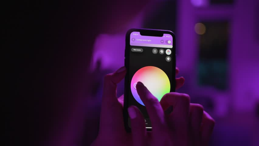 Controlling lights with an app in smart home / Smart house features / Changing mood/color of the lights  | Shutterstock HD Video #1025962796